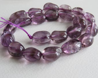 Light amethyst tumbled gemstone beads. 39cm strand. 10-12mm x 15-18mm approx.