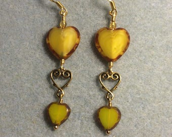 Large and small matching Czech glass heart bead dangle earrings joined by gold Tierracast heart connector charms.