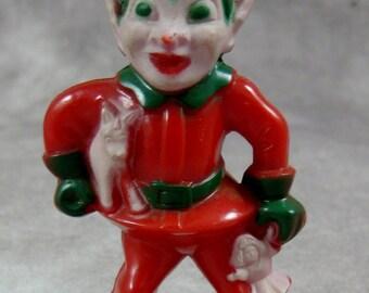 Vintage ELF Christmas Hard Plastic Pixie holding Toys Santa's Helper