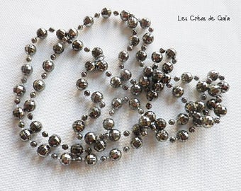 1 x necklace of faceted silver resin beads