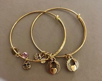 Expandable Heart/wings goldtone bracelet