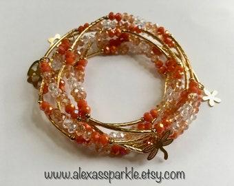 Coral transcendent beaded bracelets with gold plated charms - Semanario coral transendente con dijes de chapa de oro