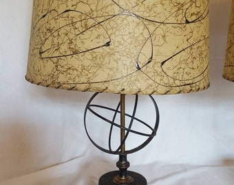 Matching pair of Mid Century, Retro, Atomic table lamps with fiberglass shades.