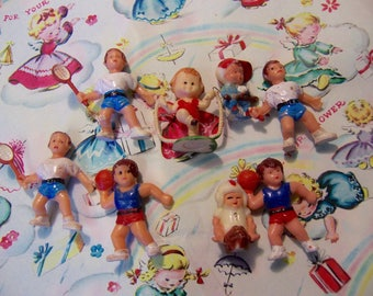 tiny plastic children playing sports figurines