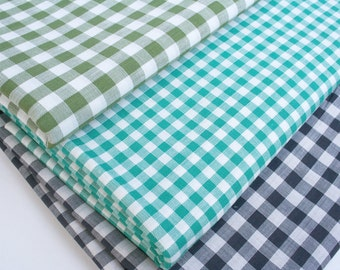 Lot of vintage plaid fabric. Cotton, cotton blend, quilting, sewing, checkers, green, black, blue green, white, classic, traditional, lot.