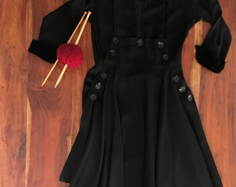 Vintage 1950s style fitted black flare dress