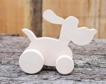 Figurine - The dog on wheels - 140 mm - made from eco-friendly alder-tree, removable wheels