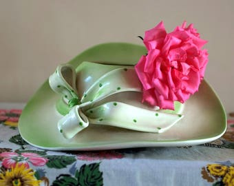 Large green ceramic hat vase with spotted bow, 1950's style.