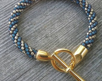 Blue and Gold Kumihimo Bracelet with Gold Toggle Clasp
