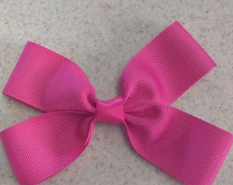 Nice and simple pink hair bow, you name the style and color and I'll make it :)