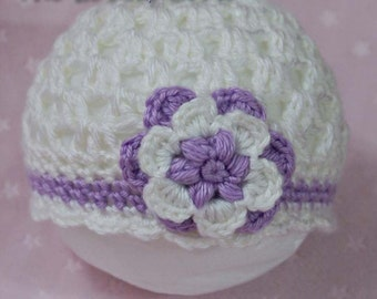 Ready to ship. Newborn Flower Flapper Beanie Hat in white and purple. MAURA Collection.