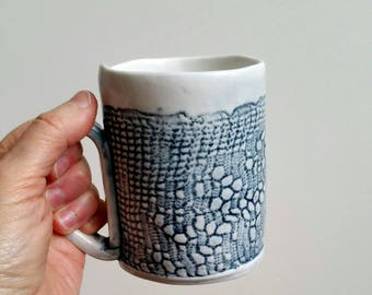 Handmade ceramic mug with impression of a vintage doily.  Rustic blue and white ceramic mug.  Porcelain mug with abstract floral pattern.