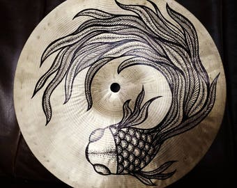 Art on cymbal - Abstract line drawing of a fish on a used Wuhan cymbal