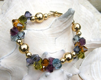 Swarvoski crystals with golden beads bracelet - Rainbow of colors