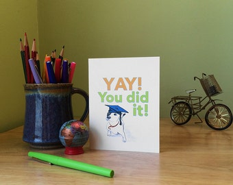 Graduation card with cute dog saying, Yay! You did it! Inside - Congratulations! (Not that we're surprised). Choice of colors.