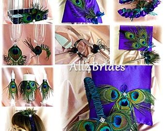 Peacock weddings purple and teal basket, pillow, guest book, flutes, cake set, garters, bag, candles, card box, headband