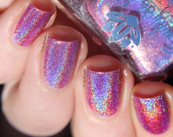 "Nail polish - ""A Veiled Promise""  A light pink strong holo"