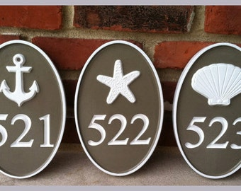 House number sign with beach theme starfish or other stock image - Carved Street address marker