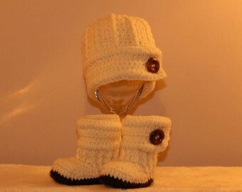 Cream baby boy hat and bootie set.