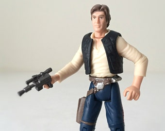 Han Solo Star Wars Action Figure with Blaster Holster & Display Stand, Solo A Star Wars Story Kids Toy, Kenner Star Wars Father's Day Gift