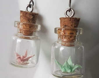 Mix and match glow in the dark origami crane in tiny glass bottle -you choose your color!