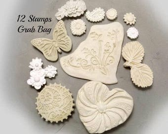 ceramic stamps - clay stamps -texture stamps -soap stamp -pottery stamps -One time grab bag of  ( 12 )  bisque stamps -  ( 294 )
