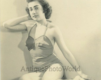 Pretty seated woman in bathing suit vintage photo