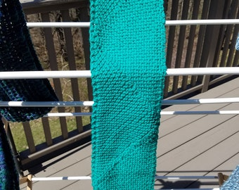 Teal green knitted scarf