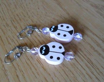 Little girl pink Ladybug earrings.