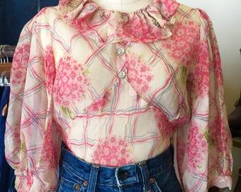 Feminine 1930s sheer chiffon bell sleeved blouse.
