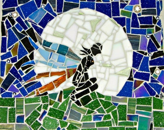 Handcrafted fairy silhouetted against the moon mosaic, midnight starry sky