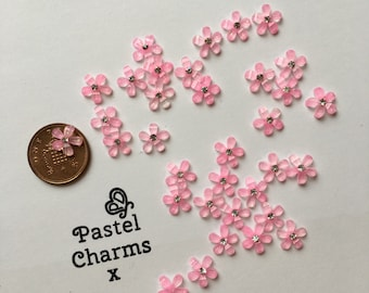 Pack of 20 pink glitter flower embellishments