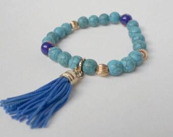 Turquoise Bracelet, Murrinas, gold laminate, blue pom pom