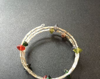 Beaded memory wire bracelet with different colours.