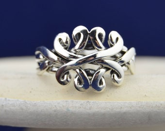 4 piece Sterling Silver Puzzle Ring in sizes 6, 7, 8, 9, 10