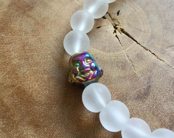 White and Rainbow Buddha: an elastic beaded bracelet with a buddha head, rainbow hematite, and white matte crystal