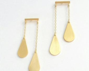 Gold minimalist balance drop earrings. Gold statement earrings. Gold stud earrings. Balance drop stud earrings.