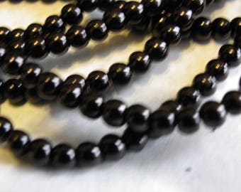 150 6 mm with a beautiful black non Pearlescent glass beads