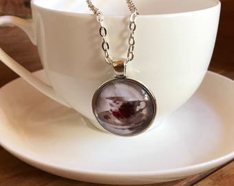 Red rose teacup glass pendant on silver rollo chain.
