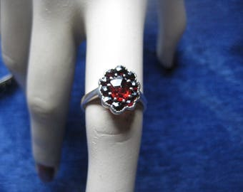 9k gold ring with garnet stones