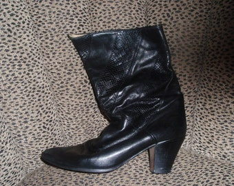 Black calf length heeled boot