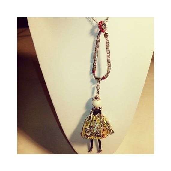 black and gold doll necklace