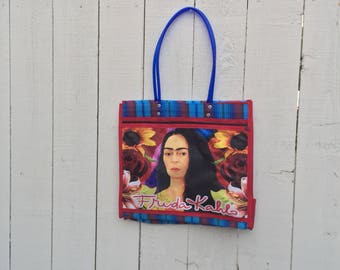 Red and blue Frida Kahlo with flowers market tote bag