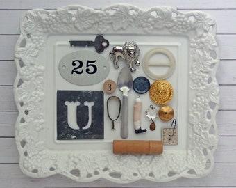 bITs KitS No041j -play spoon, belt buckle, key, curtain clip, wood needle case, metal tag, clock face, doll leg, tin stencil, lion pin