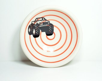 a small dish, with a monster truck print shown here on red-orange pinstripes, made to order / pick your colour