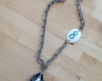Vintage frozen Charlotte necklace