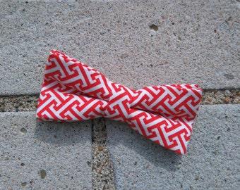 children bow tie white and orange geometrical pattern