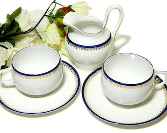 A Pair of Antique J & C Bavaria Small Teacups Saucers and Creamer Cobalt and Gold Band