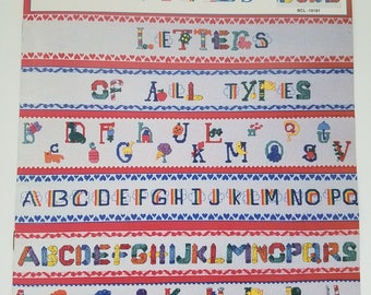 Counted cross stitch leaflet letters of all types colorful alphabets crayons fruit holidays