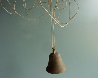 a vintage french brass bell